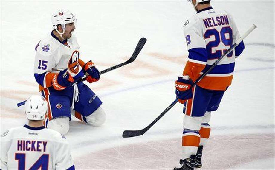 New York Islanders' Cal Clutterbuck (15) celebrates his winning goal over the Carolina Hurricanes with teammates Brock Nelson (29) and Thomas Hickey (14) during the third period of an NHL hockey game, Saturday, March 26, 2016, in Raleigh, N.C. The Islanders won 4-3. (AP Photo/Karl B DeBlaker) Photo: Karl B DeBlaker
