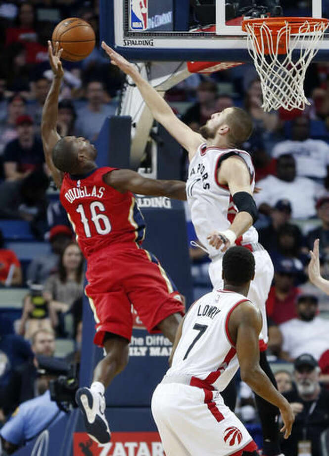 New Orleans Pelicans guard Toney Douglas (16) goes to the basket against Toronto Raptors center Jonas Valanciunas (17) in the first half of an NBA basketball game in New Orleans, Saturday, March 26, 2016. (AP Photo/Gerald Herbert) Photo: Gerald Herbert