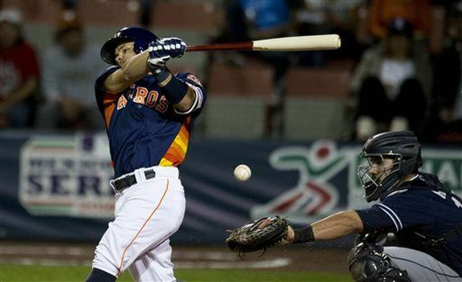 Houston Astros' Jose Altuve bats against the San Diego Padres in a spring training baseball game in Mexico City, Saturday, March 26, 2016. (AP Photo/Eduardo Verdugo) Photo: Eduardo Verdugo