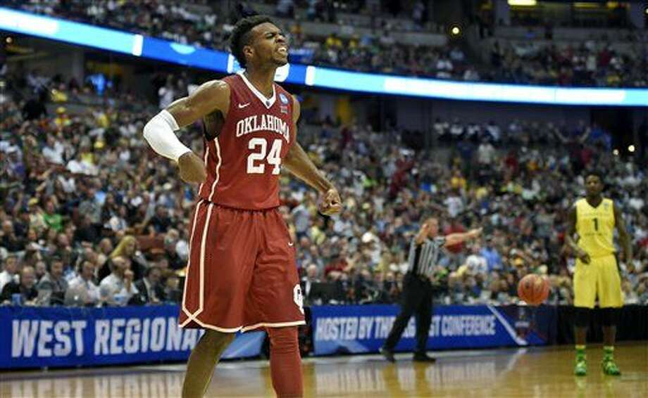 Oklahoma guard Buddy Hield celebrates after scoring during the first half of an NCAA college basketball game against Oregon in the regional finals of the NCAA Tournament, Saturday, March 26, 2016, in Anaheim, Calif. (AP Photo/Mark J. Terrill) Photo: Mark J. Terrill