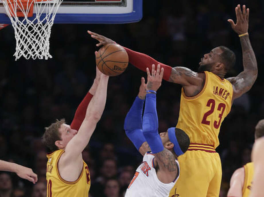 Cleveland Cavaliers forward LeBron James (23) blocks a shot by New York Knicks forward Carmelo Anthony (7) as Cleveland Cavaliers center Timofey Mozgov (20) helps defend during the second quarter of an NBA basketball game, Saturday, March 26, 2016, in New York. (AP Photo/Julie Jacobson) Photo: Julie Jacobson