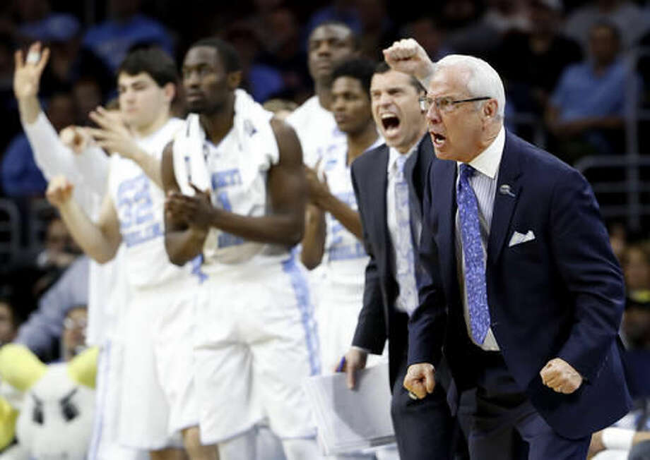 North Carolina coach Roy Williams and players react during the second half of the team's college basketball game against Indiana in the regional semifinals of the men's NCAA Tournament, early Saturday, March 26, 2016, in Philadelphia. (AP Photo/Matt Rourke) Photo: Matt Rourke