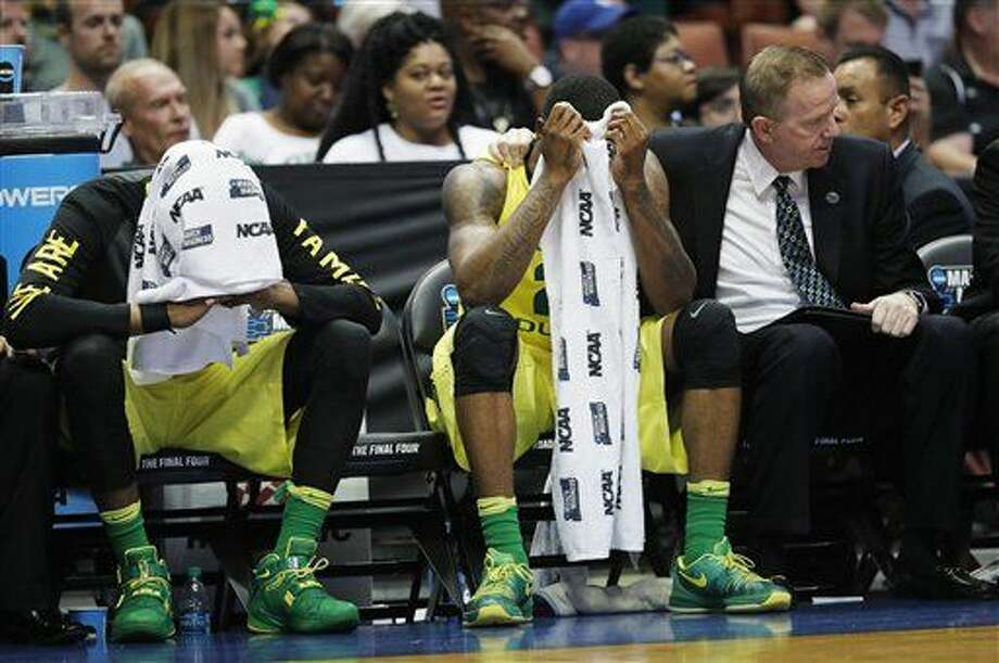 Oregon forward Dwayne Benjamin, left, and forward Elgin Cook react to their loss against Oklahoma during an NCAA college basketball game in the regional finals of the NCAA Tournament, Saturday, March 26, 2016, in Anaheim, Calif. (AP Photo/Gregory Bull) Photo: Gregory Bull