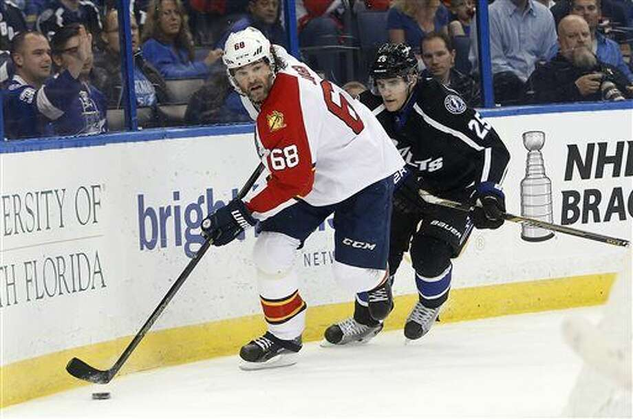 Florida Panthers right wing Jaromir Jagr (68), of the Czech Republic, controls the puck against Tampa Bay Lightning defenseman Matt Carle (25) during the first period of an NHL hockey game Saturday, March 26, 2016, in Tampa, Fla. (AP Photo/Brian Blanco) Photo: Brian Blanco