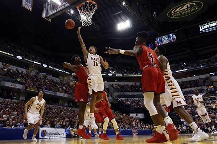 McCutcheon guard Robert Phinisee (10) shoots in front of New Albany forward Michael Maxwell (23) in the first half of the Indiana Class 4A IHSAA state championship basketball game in Indianapolis, Saturday, March 26, 2016. (AP Photo/AJ Mast) Photo: AJ MAST