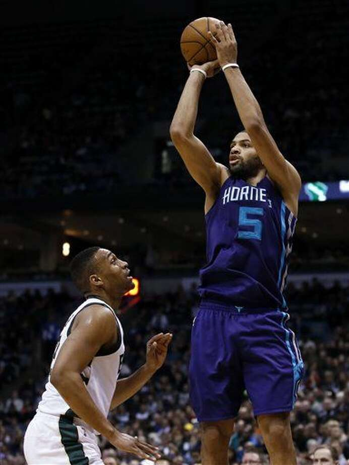 Charlotte Hornets' Nicolas Batum (5) shoots over Milwaukee Bucks' Jabari Parker during the first half of an NBA basketball game Saturday, March 26, 2016, in Milwaukee. (AP Photo/Morry Gash) Photo: Morry Gash