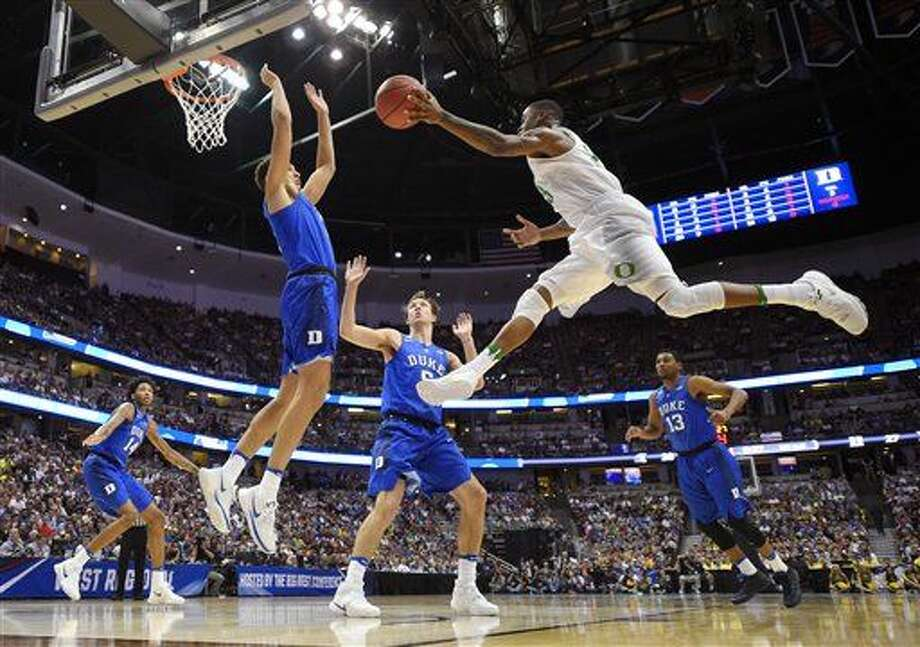 Oregon forward Dillon Brooks, right, shoot over Duke forward Chase Jeter during the first half of an NCAA college basketball game in the regional semifinals of the NCAA Tournament, Thursday, March 24, 2016, in Anaheim, Calif. (AP Photo/Mark J. Terrill) Photo: Mark J. Terrill