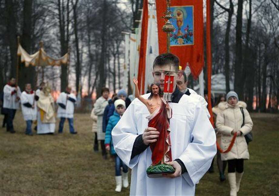 Devotees carry gonfalons during Easter Sunday rites in the village of Vselyub, 150 kilometers (93 miles) west of Minsk, Belarus, Sunday, March 27, 2016. (AP Photo/Sergei Grits) Photo: Sergei Grits
