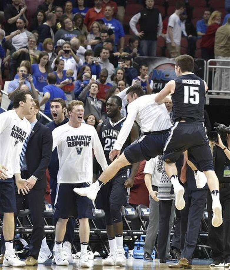 Villanova players celebrate after a regional final men's college basketball game against Kansas in the NCAA Tournament, Saturday, March 26, 2016, in Louisville, Ky. Villanova won 64-59.(AP Photo/John Flavell) Photo: John Flavell