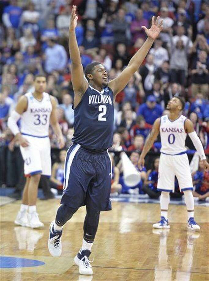 Villanova forward Kris Jenkins (2) celebrates after a regional final men's college basketball game in the NCAA Tournament against Kansas, Saturday, March 26, 2016, in Louisville, Ky. Villanova won 64-59. (AP Photo/Timothy D. Easley) Photo: Timothy D. Easley
