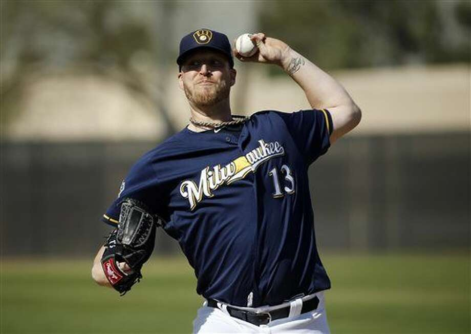 FILE - In this Tuesday, March 1, 2016 file photo, Milwaukee Brewers' Will Smith throws during a spring training baseball workout in Phoenix. The Milwaukee Brewers will start the season without reliever Will Smith, who tore a ligament in his right knee while taking his spikes off after a game, Saturday, March 26, 2016. (AP Photo/Morry Gash, File) Photo: Morry Gash