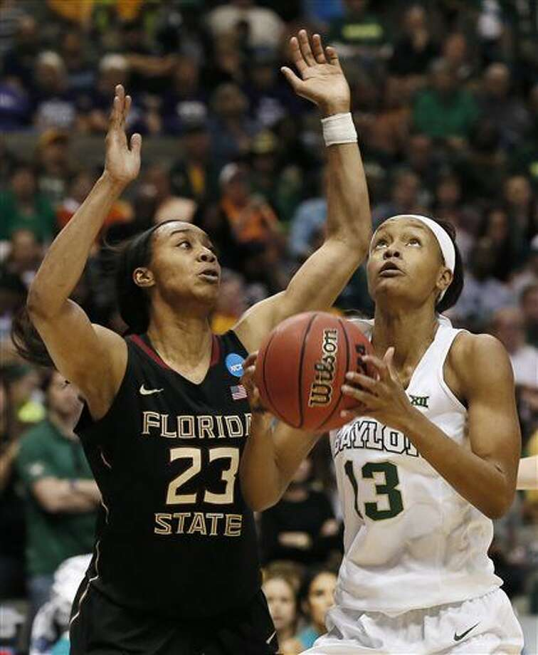 Baylor forward Nina Davis (13) attmepts a lay up as Florida State forward Ivey Slaughter (23) defends during the second half of an NCAA college basketball game in the regional semifinals of the women's NCAA Tournament Saturday, March 26, 2016, in Dallas. (AP Photo/Brandon Wade) Photo: Brandon Wade