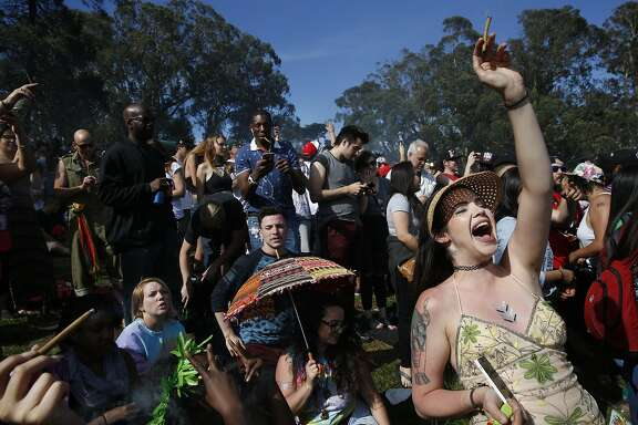 Danielle Jacques, cheers with thousands of others as the clock strikes 4:20pm during the annual 4/20 celebration in Golden Gate Park's Sharon Meadow and Hippie Hill April 20, 2016 in San Francisco, Calif.