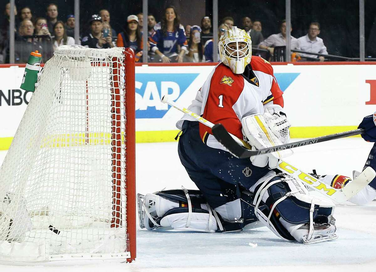 Florida Panthers goalie Roberto Luongo (1) looks back as the puck shot by New York Islanders center John Tavares slips past into the net for a goal during the second period of Game 4 of an NHL hockey first-round Stanley Cup playoff series, Wednesday, April 20, 2016, in New York. (AP Photo/Julie Jacobson) ORG XMIT: NYJJ110