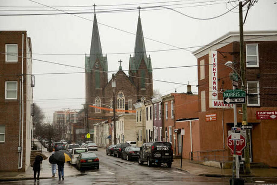 """This Feb. 23, 2016, photo shows the St. Laurentius Roman Catholic church in Philadelphia. Religious institutions and preservation groups are regularly clashing in Pennsylvania over what to do with unneeded or crumbling churches of historic significance. A.J. Thomson, whose group successfully fought last year to prevent the demolition of St. Laurentius, is still upset with the Philadelphia Archdiocese. """"In my opinion, it was all about spiting the Catholics who didn't want to follow the rules,"""" he said. (AP Photo/Matt Rourke) Photo: Matt Rourke"""