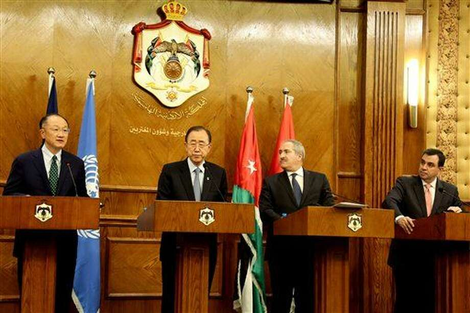 From left to right, World Bank President Jim Yong Kim, UN Secretary-General Ban Ki-moon, Jordan's Foreign Minister Nasser Judeh and Jordan's Planning Minister Imad Fakhoury, hold a press conference at the Ministry of Foreign Affairs in Amman, Jordan, Sunday, March 27, 2016. (AP Photo/Raad Adayleh) Photo: Raad Adayleh