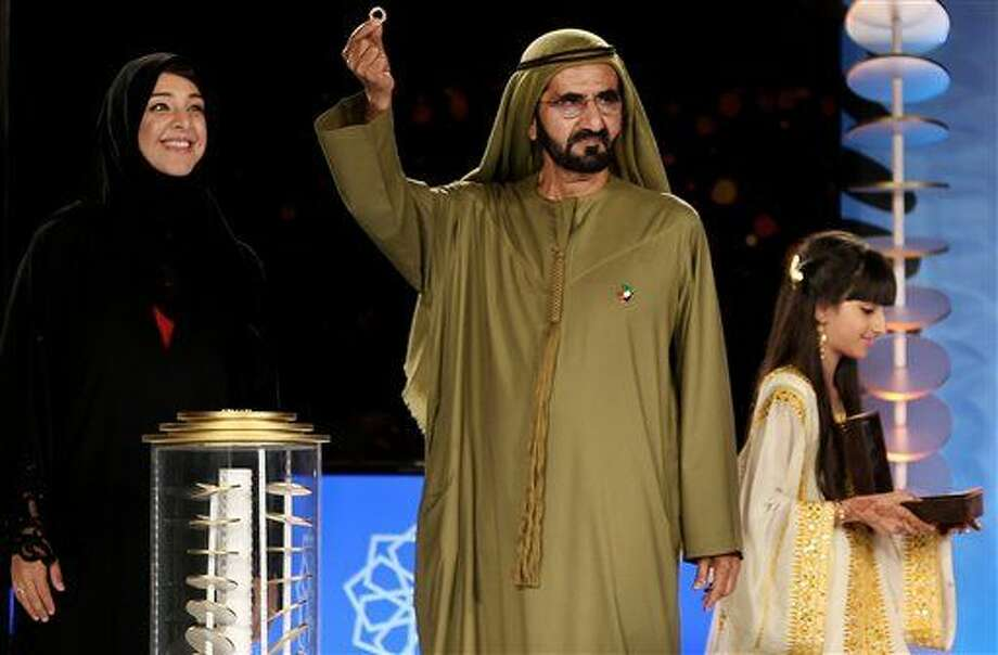 Sheikh Mohammed Bin Rashid Al Maktoum, the UAE Vice President and Ruler of Dubai presents an ancient ring discovered in UAE which inspired the new logo design for the Dubai Expo 2020, during an official ceremony in Dubai, United Arab Emirates, Sunday, March 27, 2016. Reem Ebrahim Al-Hashimi, Emirati Minister of State and Managing Director for the Dubai World Expo 2020 Bid Committee stands at left. (AP Photo/Kamran Jebreili) Photo: Kamran Jebreili