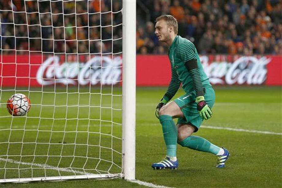 Netherlands' goalkeeper Jasper Cillessen watches the ball go into the net after France's Antoine Griezmann scored his side's first goal during a international friendly soccer match between The Netherlands and France at the ArenA stadium in Amsterdam, Netherlands, Friday, March 25, 2016. (AP Photo/Peter Dejong) Photo: Peter Dejong