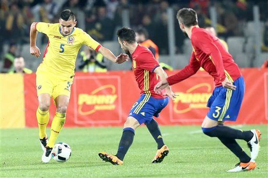 Spain's Mario Perez, center, and Gerard Pique challenge the ball with Romania's Ovidiu Stefan Hoban during a friendly soccer match between Romania and Spain in Cluj, Romania, Sunday, March 27, 2016. (AP Photo/Mircea Rosca) Photo: Mircea Rosca