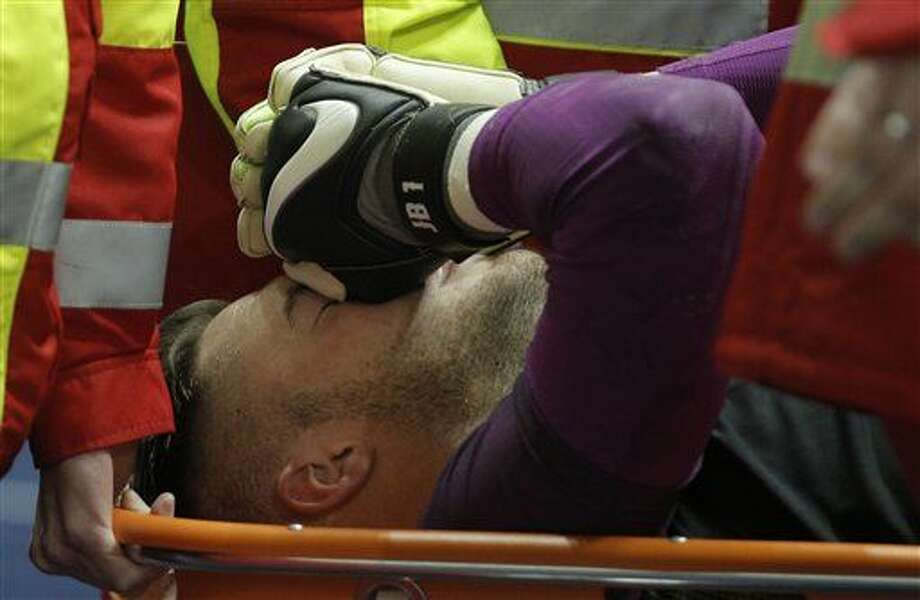 England's goalkeeper Jack Butland lies on a stretcher after suffering an injury during a friendly soccer match between Germany and England in Berlin, Germany, Saturday, March 26, 2016. (AP Photo/Gero Breloer) Photo: Gero Breloer