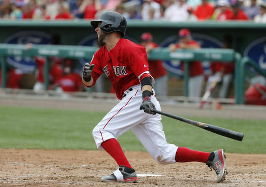 Boston Red Sox's Dustin Pedroia follows through on a single off a pitch from Philadelphia Phillies' Jerad Eickhoff in the fourth inning of an interleague spring training baseball game, Sunday, March 27, 2016, in Sarasota, Fla. (AP Photo/Tony Gutierrez) Photo: Tony Gutierrez