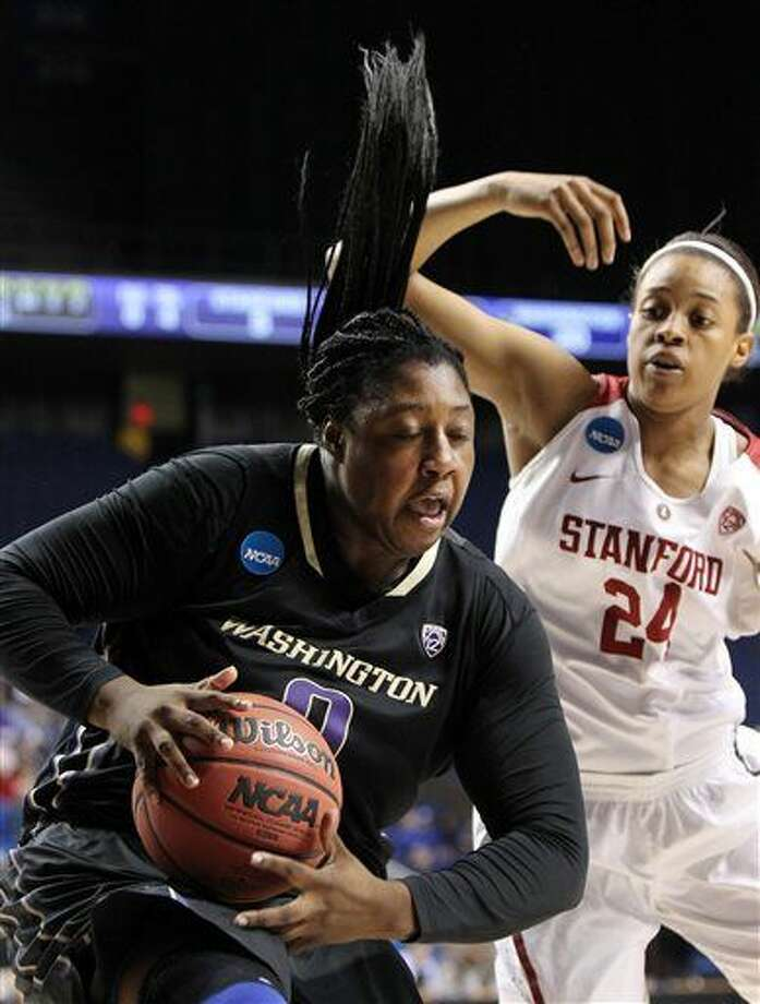 Washington's Chantel Osahor, left, pulls down a rebound near Stanford's Erica McCall (24) during a regional final women's college basketball game in the NCAA Tournament in Lexington, Ky., Sunday, March 27, 2016. (AP Photo/James Crisp) Photo: James Crisp