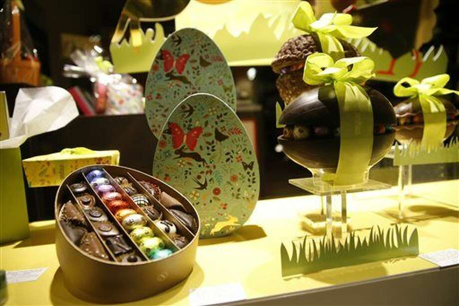 This Saturday, March 26, 2016 photo shows chocolate Easter Eggs on display in a shop near the EU Commission in Brussels. While chocolatiers throughout the city are quick to offer condolences to the victims of the tragedy, they are equally fast to express concern about the future. Their livelihoods depend on people from around the globe streaming into their shops to indulge in their world famous goodies _ and they know tourists don't go anywhere to be afraid. (AP Photo/Alastair Grant) Photo: Alastair Grant