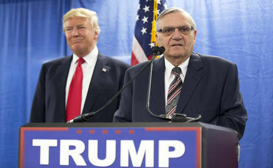 FILE - In this Jan. 26, 2016 file photo, Republican presidential candidate Donald Trump, left, is joined by Maricopa County, Ariz., Sheriff Joe Arpaio during a new conference in Marshalltown, Iowa. Arizona's presidential primary marked a return to the political spotlight for Arpaio, an influential figure in Republican circles on immigration enforcement who has spent the last year lying low as he faces the possibility of criminal charges. His endorsement of Republican front-runner Donald Trump led to a round of TV interviews and appearances with the candidate, including a rally in Arpaio's hometown.(AP Photo/Mary Altaffer, File) Photo: Mary Altaffer