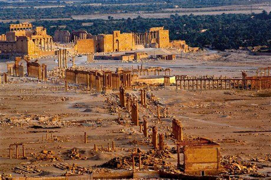This undated photo released by the Syrian official news agency SANA, shows the site of the ancient city of Palmyra, Syria. Palmyra is an archaeological gem that Syrian troops took back from Islamic State fighters on Sunday, March 27, 2016. Syrian state media and an opposition monitoring group say government forces backed by Russian airstrikes have driven Islamic State fighters from the historic central town of Palmyra, held by the extremists since May. (SANA via AP)