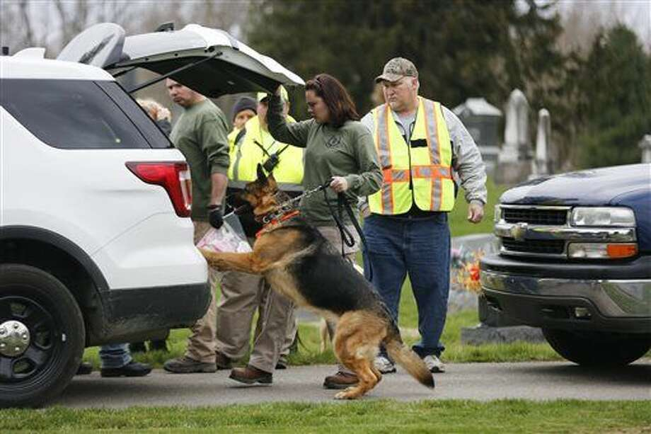 In a Wednesday, March 23, 2016 photo, a search and rescue dog is prepared to search the area near a house where a baby disappeared in Spencer, Ind. Shaylyn Ammerman was reported missing from her crib by her grandmother Wednesday morning. The search continued Thursday. (Jeremy Hogan/Bloomington Herald-Times via AP) (Jeremy Hogan/(/The Herald-Times via AP) MANDATORY CREDIT Photo: Jeremy Hogan