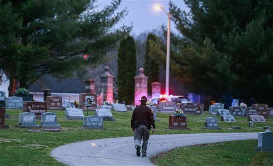 In a Wednesday, March 23, 2016 photo, a police officer looking for a missing toddler Shaylyn Ammerman walks through Riverside Cemetery in Spencer, Ind. Shaylyn Ammerman was reported missing from her crib by her grandmother Wednesday morning. The search continued Thursday. (Jeremy Hogan/(/The Herald-Times via AP) MANDATORY CREDIT Photo: Jeremy Hogan