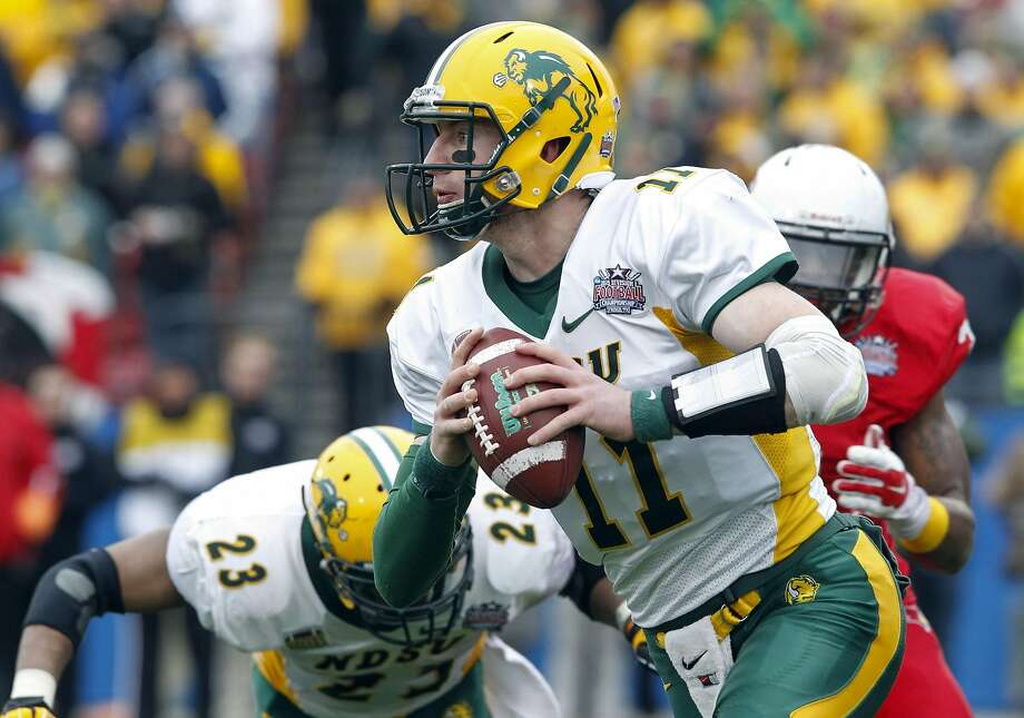 FILE - In this Jan. 10, 2016, file photo, North Dakota State quarterback Carson Wentz (11) carries the ball during the FCS championship NCAA college football game against Illinois State in Frisco, Texas.   Wents is one of the top offensive players available in the NFL Draft, which starts April 28 in Chicago.  (AP Photo/Tim Sharp, File) Photo: TIM SHARP, Associated Press