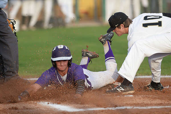 Nederland's Brendan Dunkleberger goes for the out against Port Neches-Groves' Cole Girouard as he rush to cover home plate during Wednesday's match-up at Nederland High School. Photo taken Wednesday, April 20, 2016 Kim Brent/The Enterprise