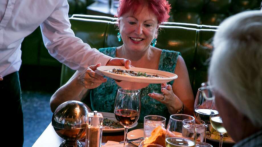 A server brings food to a table at Original Joe's Westlake in Daly City. Photo: John Storey, Special To The Chronicle