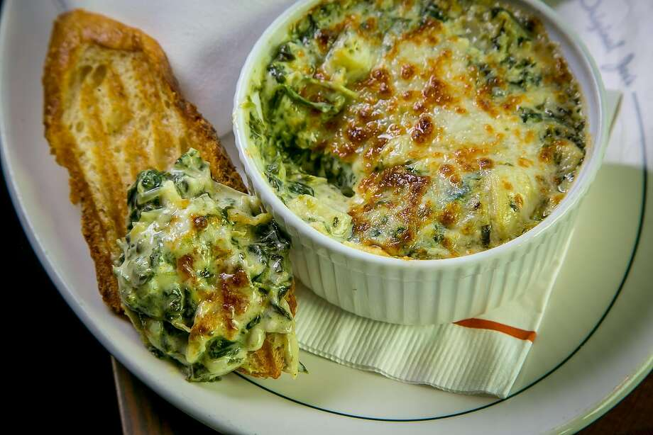 The gooey and comforting spinach artichoke dip at Original Joe's Westlake. Photo: John Storey, Special To The Chronicle