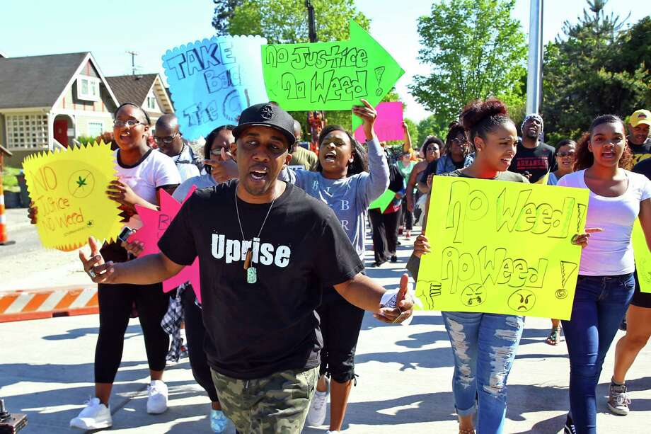Seattle rapper Draze and members of the Hazen High School Black Student Union lead the Irony on 23rd petition and Unity on Union protest, from Garfield High School to Uncle Ike's Pot Shop, Wednesday, April 20, 2016.  Protesters gathered in opposition of Uncle Ike's Pot Shop, which opened in 2014 at the corner of 23rd Avenue and East Union Street next door to Mount Calvary Christian Center and across the street from a teen center.  Draze recently released a song titled Irony on 23rd about the issue. Photo: GENNA MARTIN, SEATTLEPI.COM / SEATTLEPI.COM