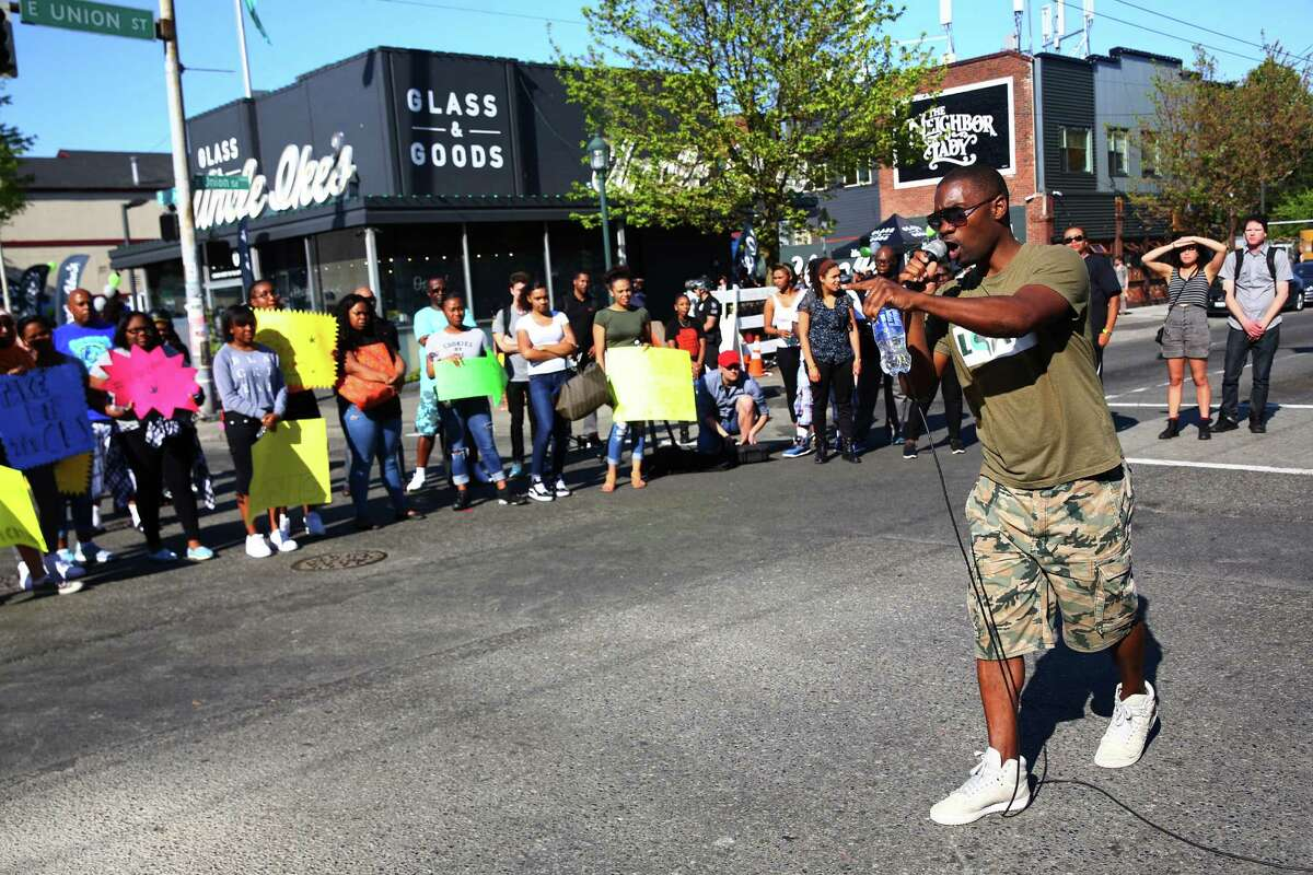 Amari King, who grew up in the Central District speaks to a crowd during the Unity on Union protest, Wednesday, April 20, 2016. Protesters gathered in opposition of Uncle Ike's Pot Shop, which opened in 2014 at the corner of 23rd Avenue and East Union Street next door to Mount Calvary Christian Center and across the street from a teen center.