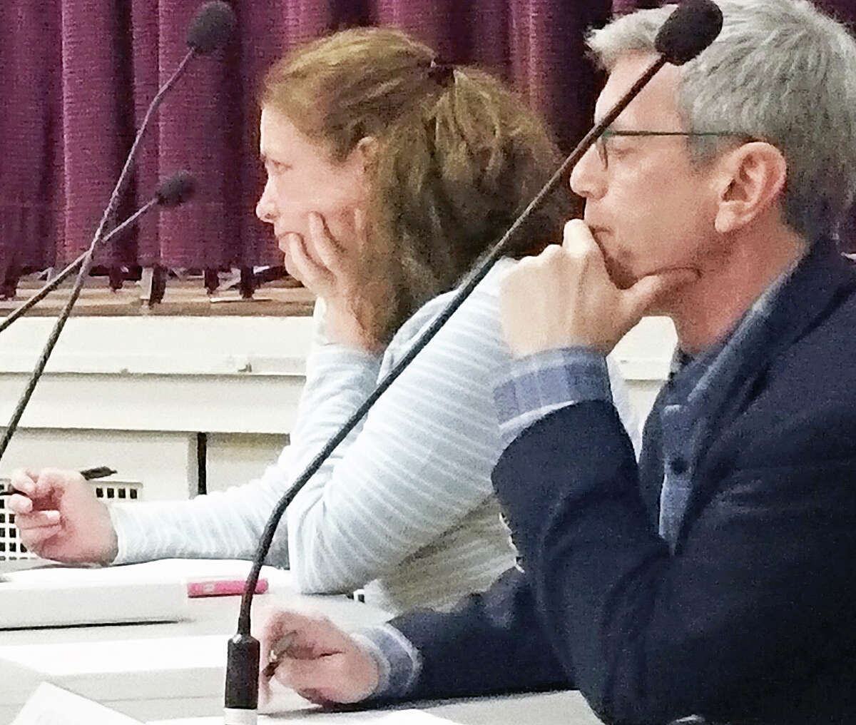 Board of Education members Jessica Gerber and Marc Patten at Wednesday's special school board meeting regarding the governor's proposed budget.