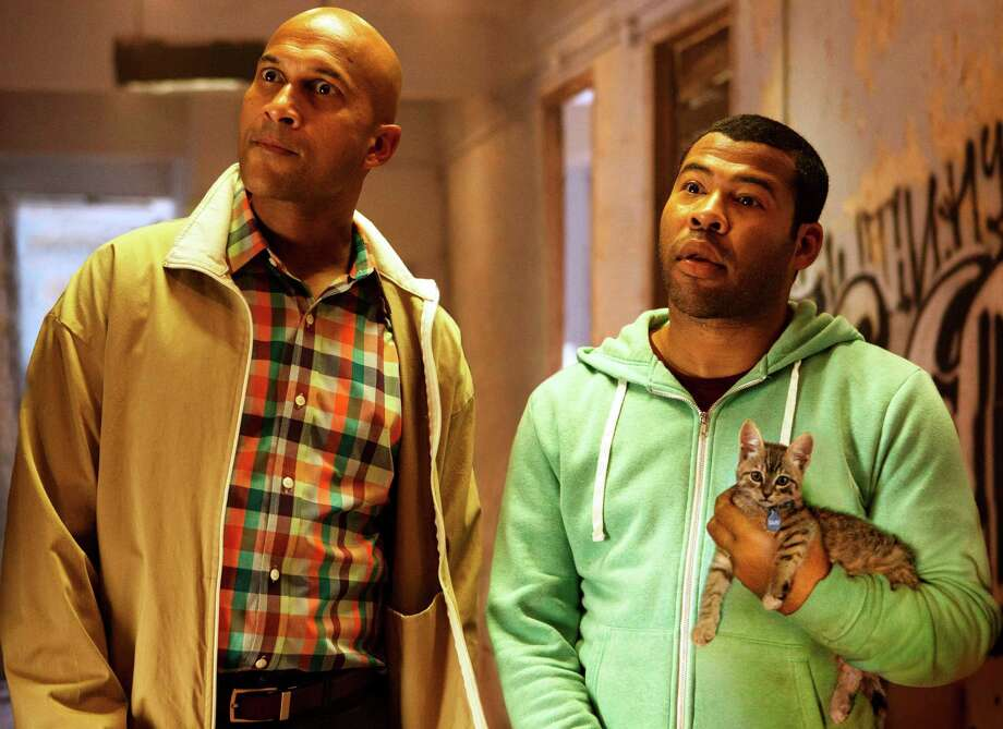 "(L-r) KEEGAN-MICHAEL KEY as Clarence and JORDAN PEELE as Rell in ""KEANU,"" Photo: Steve Dietl / Warner Bros. Pictures / © 2015 Warner Bros. Entertainment Inc. All Rights Reserved."