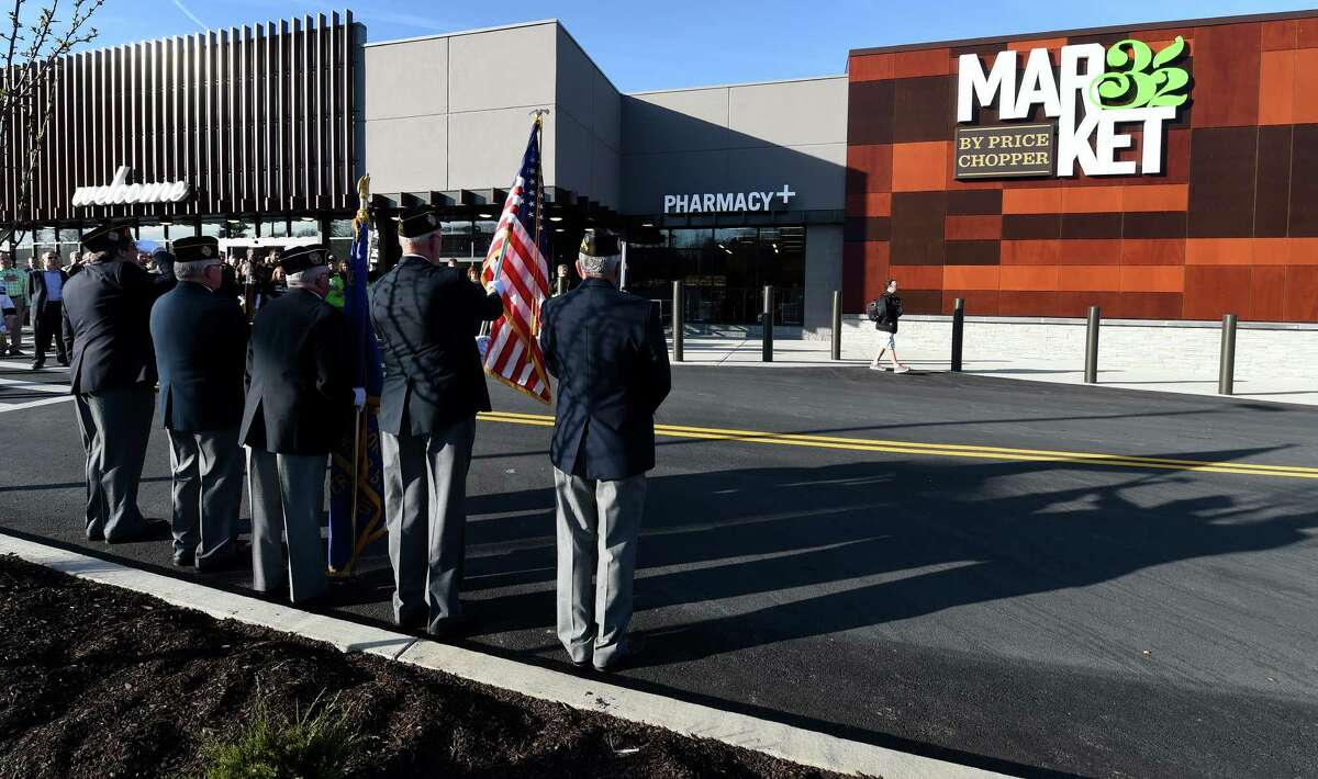 VFW Post 8692 presents the American Flag as the National Anthem is played at the grand opening of the Market 32 Thursday April 21, 2016 in Guilderland, N.Y. This Market 32 is one of four that are opening today in the region. (Skip Dickstein/Times Union)