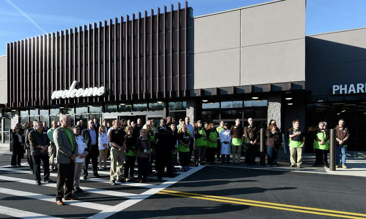 All the employees stand outside the new store as the National Anthem is played at the grand opening of the Market 32 Thursday April 21, 2016 in Guilderland, N.Y. This Market 32 is one of four that are opening today in the region. (Skip Dickstein/Times Union)