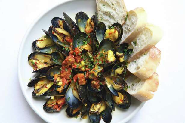 Spanish chorizo accents mussels in a saffron broth.