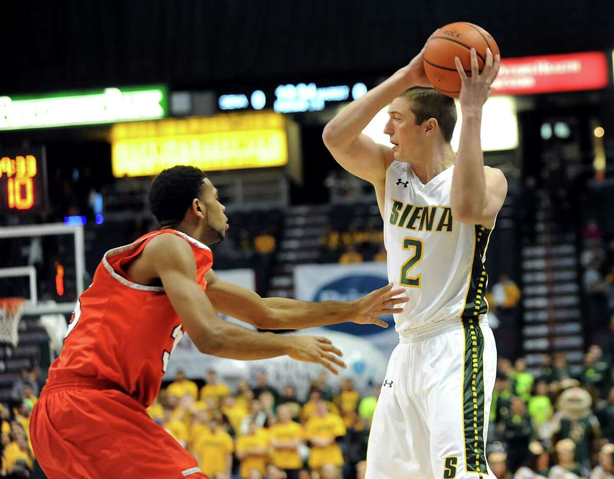 Siena's Willem Brandwijk, right, looks to pass as Marist's Phillip Lawrence defends during their basketball game on Friday, Jan. 23, 2015, at Times Union Center in Albany, N.Y. (Cindy Schultz / Times Union)