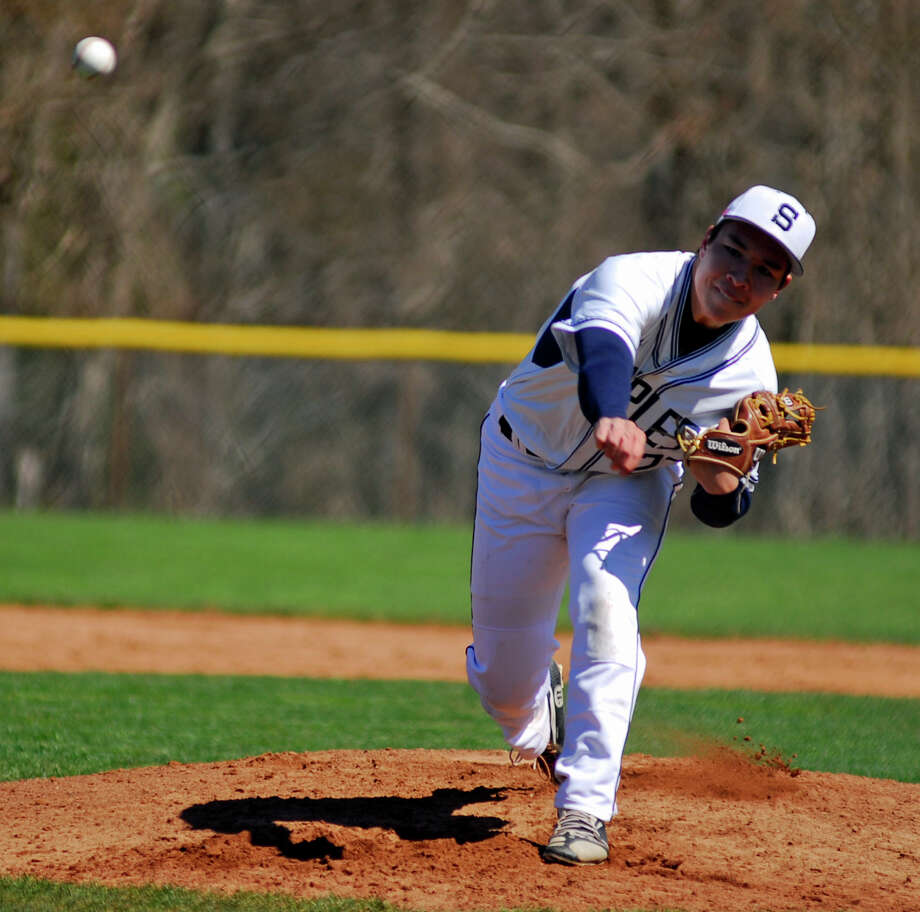 Staples freshman Chad Knight tosses a pitch during a baseball game against Amity Regional on Sunday, April 10th 2016. Photo: Ryan Lacey/Staff Photo / Westport News Contributed