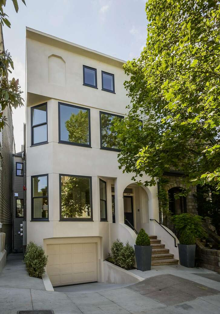 This partially detached building in Cole Valley houses a pair of two-level residences.�