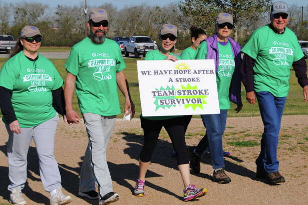 Stroke survivors Malcom Krause, right, and Preston Worley, second from left, participate in the Stepping Out Against Stroke 3K at Seabourne Creek Nature Park. Joining them are Dallas Williams, left, stroke therapist Kelley Drabek and Elaine Krause.