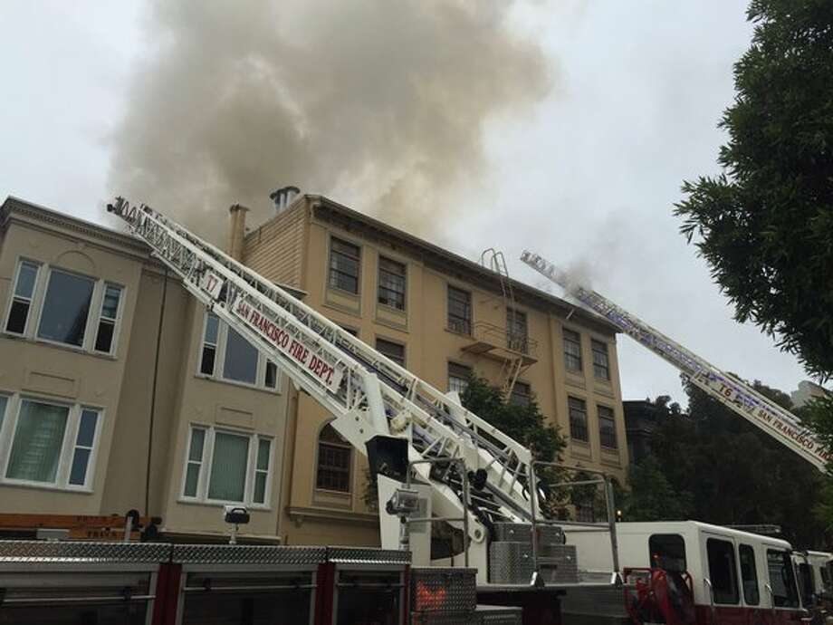 A two-alarm fire broke out in an four-story apartment building in San Francisco's Mission District on Thursday, April 21, 2016.