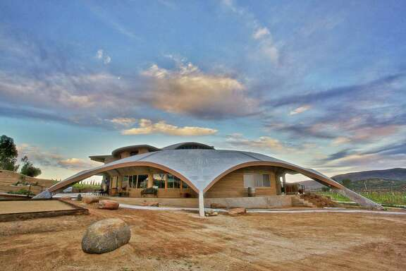Exterior of Alximia, a winery in Baja California. The winery's headquarters is referred to as the spaceship that landed in Valle de Guadalupe. The roof actually slopes downward into collection points that funnel rainwater to underground tanks that can later be recycled back into the vineyards.
