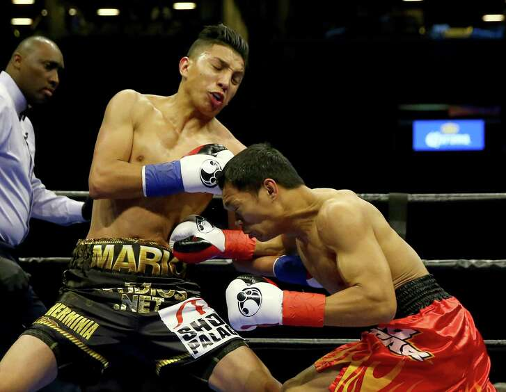 NEW YORK, NY - APRIL 16: Mario Barrios and Edgar Gabejan exchange punches during their lightweight bout at Barclays Center on April 16, 2016 in the Brooklyn borough of New York City. (Photo by Elsa/Getty Images)