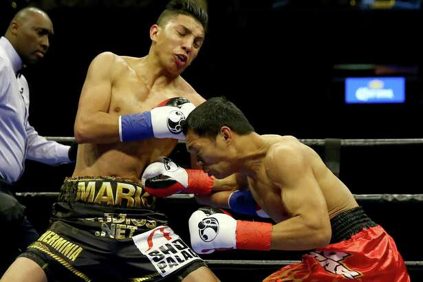 San Antonio's Mario Barrios (left) and Edgar Gabejan exchange punches during their lightweight bout at Barclays Center on April 16, 2016 in Brooklyn, New York.